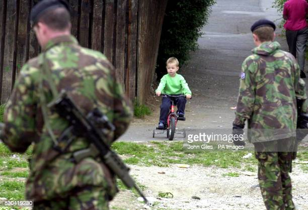 A youngster from the Garvaghy Road watches a British Army Patrol make a security check as soldiers have erected barbed wire barricades to separate...
