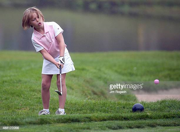A youngster participates in the Chip Competition during the Drive Chip and Putt Championship at The Country Club on September 13 2015 in Brookline...