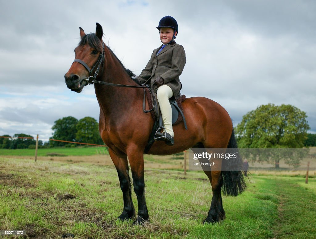 A youngster sits on his pony waiting to compete during the 194th Sedgefield Show on August 12, 2017 in Sedgefield, England. The annual show is held on the second Saturday each August and is a celebration of agricultural and country life. It offers a range of competitive classes which represent the many skills and aspects of life in the local community, and the countryside including animal classes, vintage machinery and handicrafts.