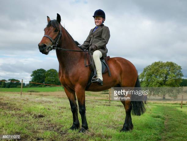 A youngster sits on his pony waiting to compete during the 194th Sedgefield Show on August 12 2017 in Sedgefield England The annual show is held on...