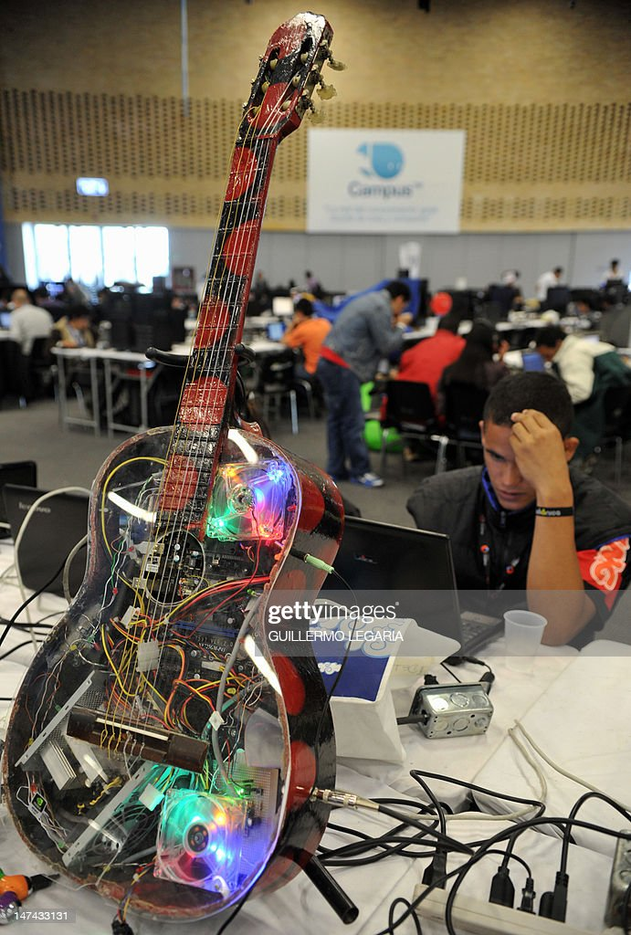 A youngster takes part in the fifth edition of Colombia's Campus Party, next to a modded computer, on June 29, 2012, in Bogota. The Campus Party is considered the biggest event of technology, innovation, creativity, leisure and culture in the digital network world. AFP PHOTO/Guillermo LEGARIA