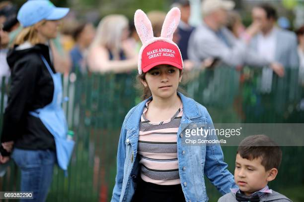 A youngster wears a 'Make America Great Again' hat with bunny ears during the 139th Easter Egg Roll on the South Lawn of the White House April 17...