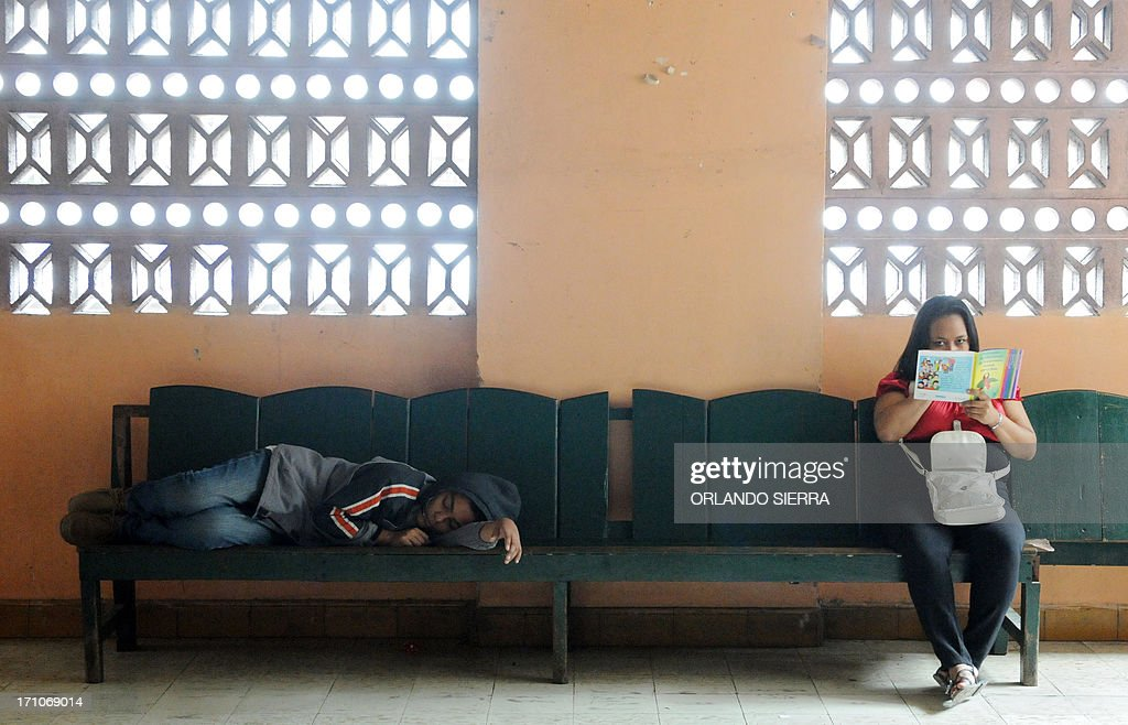 A youngster with dengue symptoms waits for medical attention in a health center in Tegucigalpa on June 21, 2013. Health authorities will ask the government to decree a state of emergency due to the spread of the mosquito. AFP PHOTO /Orlando SIERRA.