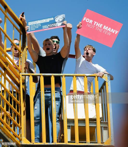 Youngsters climb a helter skelter ride to wave placards supporting the Labour Party during the 133rd Durham Miners Gala on July 8 2017 in Durham...