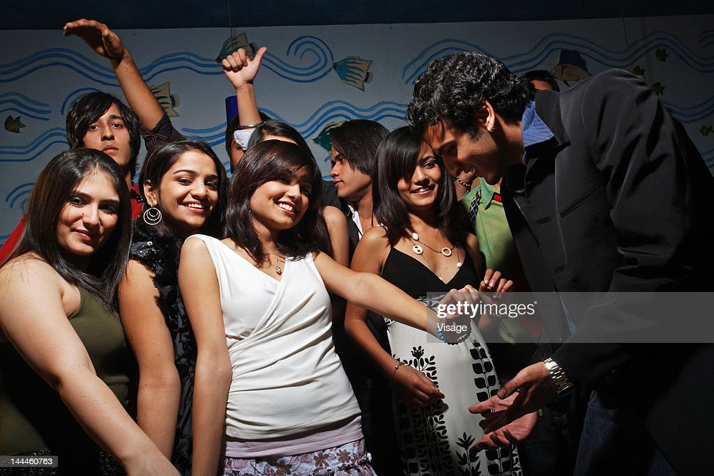 Youngsters dancing at a party : Stock Photo