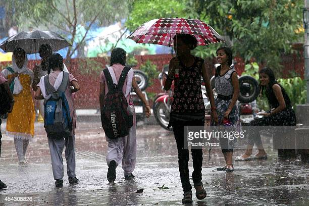 Youngsters enjoying in the rain as local residents were relieved from the scorching heat as rain falls in some parts of New Delhi bringing the...