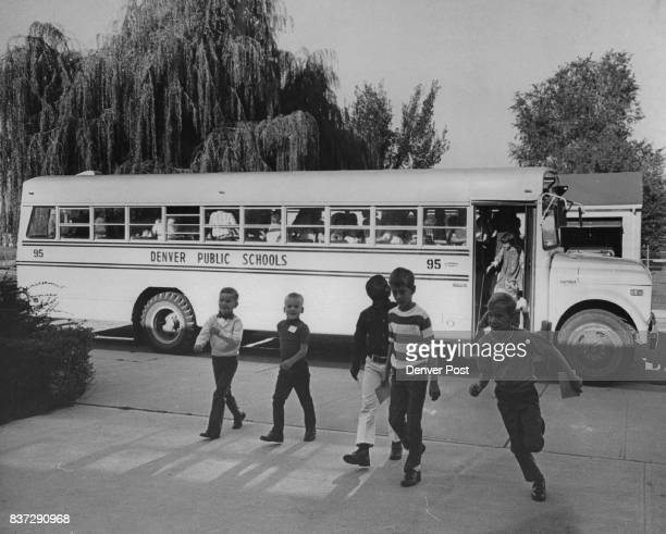 Youngsters leave bus to enter Barrett School 2900 Jackson St to integrate school which has been 90 per cent Negro since it opened in 1960 Pupils from...