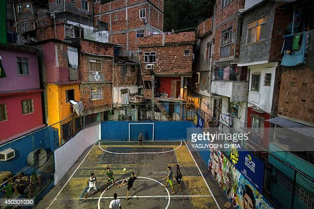 Youngsters play football at a field of Tavares Bastos shantytown in Rio de Janeiro Brazil on June 8 just four days ahead of the FIFA World Cup 2014...