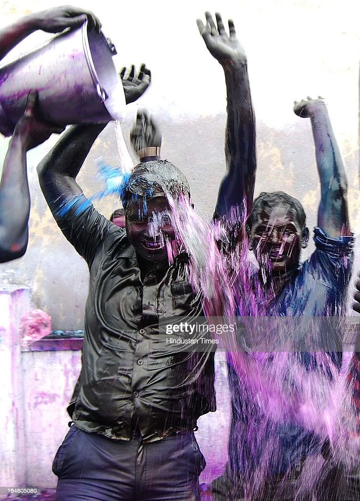 Youngsters play with colours and dance during Holi festival celebration on March 28, 2013 in Allahabad, India. Holi, festival of color is Hindu religious festival also called Basantotsav or spring festival as it mark the arrival of spring. People gather together to play colors, sing and dance to traditional tunes and eat sweets specially Gujiyas.