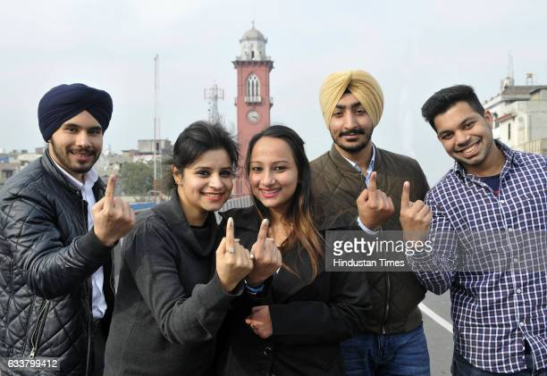 Youngsters posing for the photograph and showing their inked fingers in front of Clock Tower on February 4 2017 in Ludhiana India Punjab on Saturday...