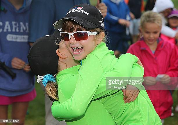 Youngsters react as they await the results of the Drive Chip and Putt Championship at The Country Club on September 13 2015 in Brookline Massachusetts