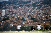 Youngsters sit on the ground in the Commune 4 Moravia shantytown in Medellin Antioquia department Colombia on April 9 2014 Moravia which in 30 years...