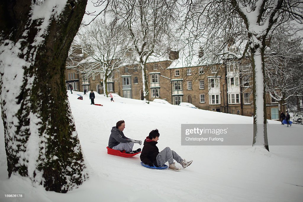 Youngsters take advantage of the snow and go sledging on The Slopes on January 21, 2013 in Buxton, United Kingdom. The Met Office has issued a red weather warning for parts of the Uk and advising against all non-essential travel as up to 30cm of snow is expected to fall in some areas today. The adverse weather has closed nearly 5,000 schools and caused many airports to cancel flights.