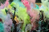 Youngsters throw colored powder at each other during the Festival of Colors in St Petersburg on July 19 2014 The feastival is based on the Indian...