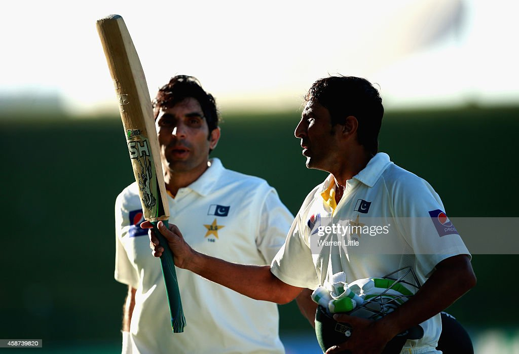 <a gi-track='captionPersonalityLinkClicked' href=/galleries/search?phrase=Younis+Khan&family=editorial&specificpeople=585162 ng-click='$event.stopPropagation()'>Younis Khan</a> and <a gi-track='captionPersonalityLinkClicked' href=/galleries/search?phrase=Misbah-ul-Haq&family=editorial&specificpeople=2180557 ng-click='$event.stopPropagation()'>Misbah-ul-Haq</a> of Pakistan acknowledge the crowd as they leave the field after both reaching their centuries during day two of the first test between Pakistan and New Zealand at Sheikh Zayed stadium on November 10, 2014 in Abu Dhabi, United Arab Emirates.