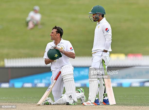 Younis Khan and Muhammad Rizwan of Pakistan await a DRS call on LBW on Younis Khan during day five of the Second Test match between New Zealand and...