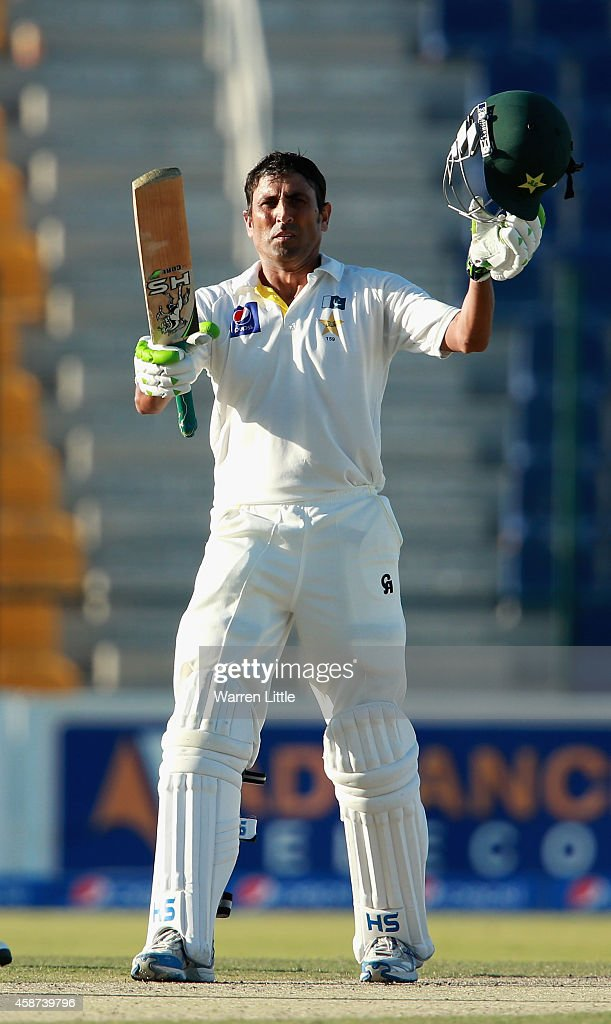 <a gi-track='captionPersonalityLinkClicked' href=/galleries/search?phrase=Younis+Khan&family=editorial&specificpeople=585162 ng-click='$event.stopPropagation()'>Younis Khan</a> of Pakistan acknowledges the crowd after reaching his century during day two of the first test between Pakistan and New Zealand at Sheikh Zayed stadium on November 10, 2014 in Abu Dhabi, United Arab Emirates.