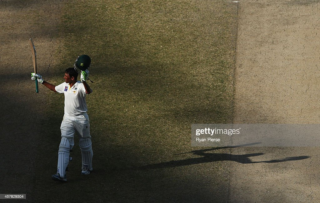<a gi-track='captionPersonalityLinkClicked' href=/galleries/search?phrase=Younis+Khan&family=editorial&specificpeople=585162 ng-click='$event.stopPropagation()'>Younis Khan</a> of Pakistan celebrates after reaching his century during Day Four of the First Test between Pakistan and Australia at Dubai International Stadium on October 25, 2014 in Dubai, United Arab Emirates.