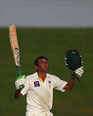 Younis Khan of Pakistan celebrates after reaching his century during Day One of the Second Test at Sheikh Zayed Stadium on October 30 2014 in Abu...