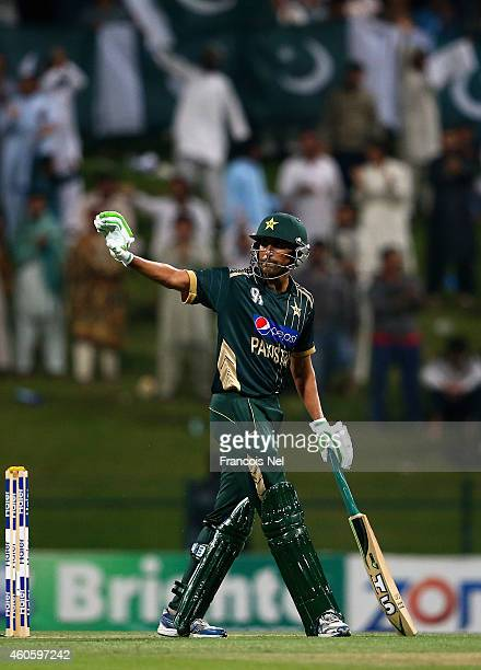 Younis Khan of Pakistan celebrates after reaching his century during the 4th One Day International match between Pakistan and New Zealand at Sheikh...