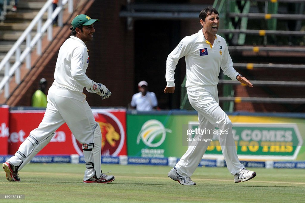 <a gi-track='captionPersonalityLinkClicked' href=/galleries/search?phrase=Younis+Khan&family=editorial&specificpeople=585162 ng-click='$event.stopPropagation()'>Younis Khan</a> of Pakistan celebrates the wicket of Hashim Amla of South Africa during day 1 of the first Test match between South Africa and Pakistan at Bidvest Wanderers Stadium on February 01, 2013 in Johannesburg, South Africa.