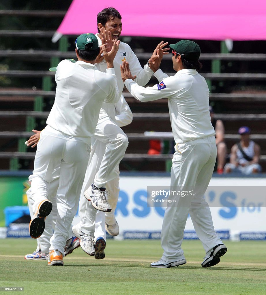 <a gi-track='captionPersonalityLinkClicked' href=/galleries/search?phrase=Younis+Khan&family=editorial&specificpeople=585162 ng-click='$event.stopPropagation()'>Younis Khan</a> of Pakistan celebrates the wicket of Hashim Amla of South Africa with his team mates during day 1 of the first Test match between South Africa and Pakistan at Bidvest Wanderers Stadium on February 01, 2013 in Johannesburg, South Africa.