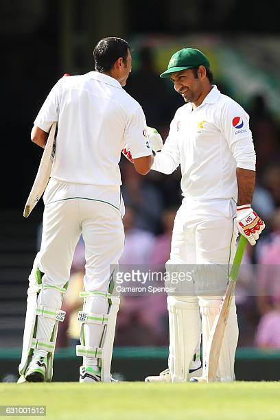 Younis Khan of Pakistan is congratulated by team mate Sarfraz Ahmed after scoring a century during day three of the Third Test match between...
