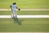 Younis Khan of Pakistan is embraced by team mate Azhar Ali after reaching his century during day one of the second test between Pakistan and...