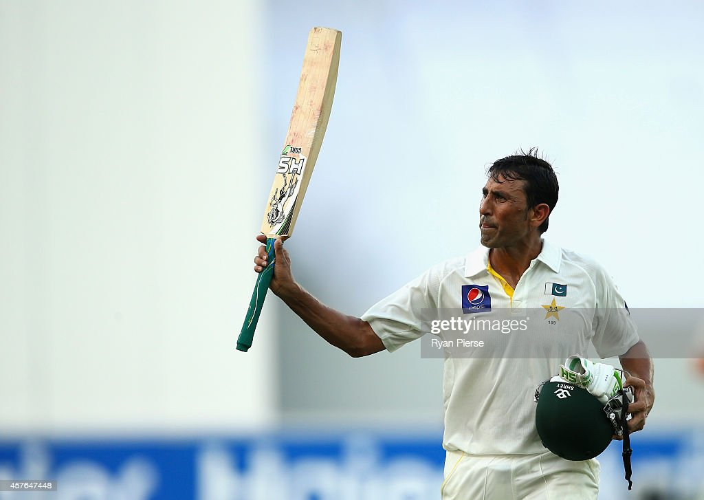 <a gi-track='captionPersonalityLinkClicked' href=/galleries/search?phrase=Younis+Khan&family=editorial&specificpeople=585162 ng-click='$event.stopPropagation()'>Younis Khan</a> of Pakistan leaves the ground after being dismissed for 106 runs by Mitchell Johnson of Australia during Day One of the First Test between Pakistan and Australia at Dubai International Stadium on October 22, 2014 in Dubai, United Arab Emirates.