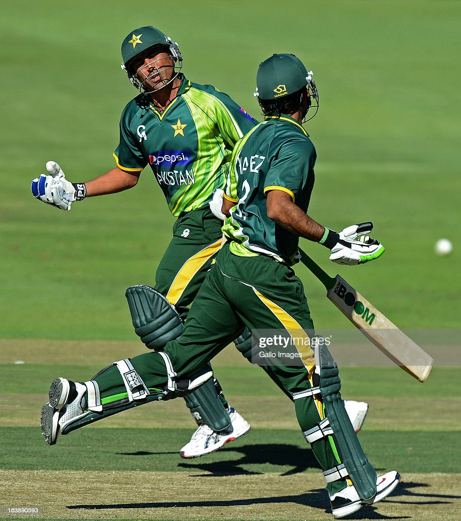 <a gi-track='captionPersonalityLinkClicked' href=/galleries/search?phrase=Younis+Khan&family=editorial&specificpeople=585162 ng-click='$event.stopPropagation()'>Younis Khan</a> of Pakistan runs a single with Muhammad Hafeez during the 3rd One Day International match between South Africa and Pakistan at Bidvest Wanderers Stadium on March 17, 2013 in Johannesburg, South Africa.