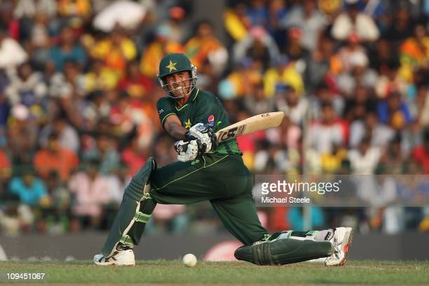 Younis Khan of Pakistan sweeps during the Pakistan v Sri Lanka 2011 ICC World Cup Group A match at the R Premadasa Stadium on February 26 2011 in...