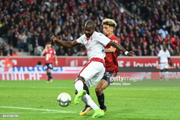 Younousse Sankhare of Bordeaux and Kevin Malcuit of Lille during the Ligue 1 match between Lille OSC and FC Girondins de Bordeaux at Stade Pierre...