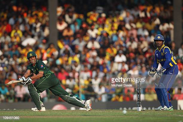 Younus Khan of Pakistan plays to the legside as wicketkeeper Kumar Sangakkara looks on during the Pakistan v Sri Lanka 2011 ICC World Cup Group A...