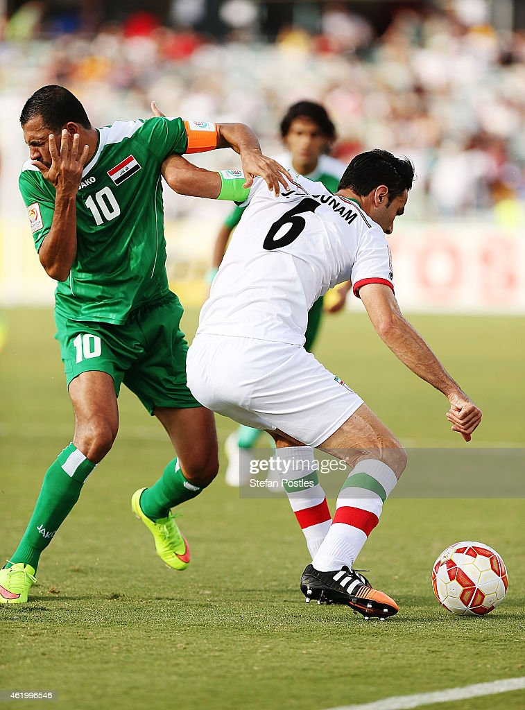 Younus Mahmood of Iraq reacts after receiving an elbow in the face from Javad Nekonam of Iran during the 2015 Asian Cup match between Iran and Iraq at Canberra Stadium on January 23, 2015 in Canberra, Australia.