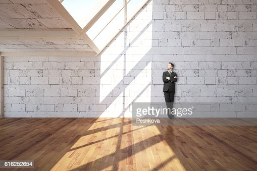 Youong man in interior : Stock Photo