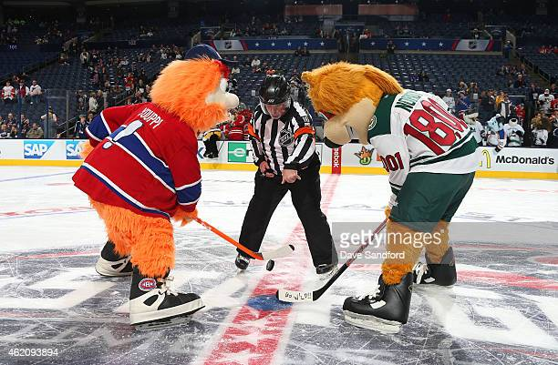 Youppi of the Montreal Canadiens and Nordy of the Minnesota Wild take a faceoff at center ice during the mascot showdown as part of the 2015 NHL...
