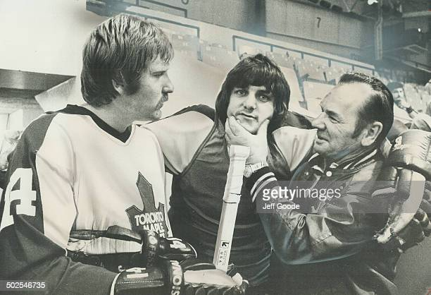 You're a cutie Maple Leafs' goaltender coach Johnny Bower right just wanted to cuddle defenceman Bob Neely when the two met yesterday as training...