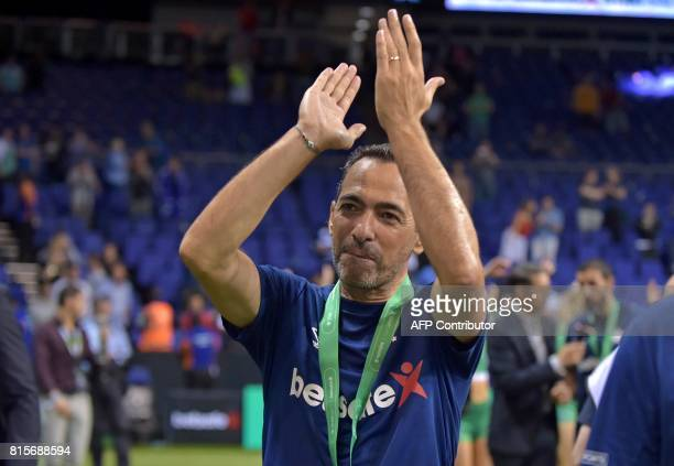Youri Djorkaeff applauds as France celebrate their victory after the Star Sixes final football match between France and Denmark at the O2 Arena in...