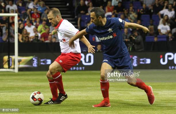 Youri Djorkaeff of France and Daniel Jensen of Denmark in action during the Final Star Sixes match between France and Denmark at The O2 Arena on July...
