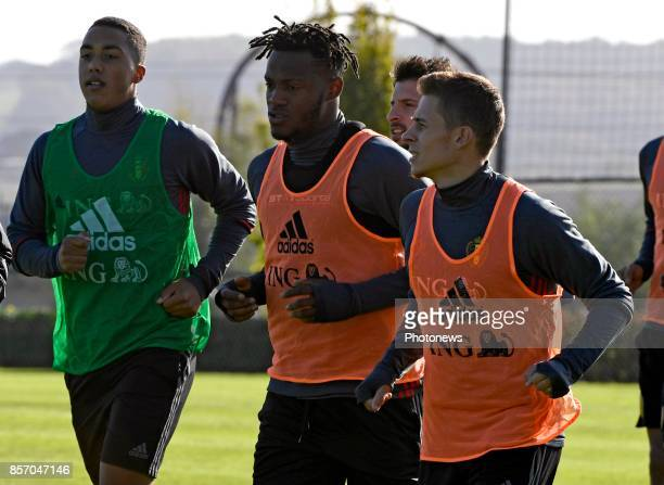 Youri Tielemans midfielder of Belgium and Thorgan Hazard midfielder of Belgium with Michy Batshuayi forward of Belgium during training session of the...