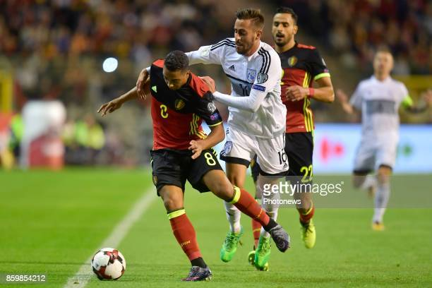 Youri Tielemans midfielder of Belgium battles for the ball with Charalambos Kyriakou forward of Cyprus during the World Cup Qualifier Group H match...