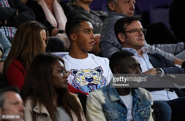 Youri Tielemans midfielder of RSC Anderlecht watching the game from the stand with girlfriend pictured during Jupiler Pro League match between RSC...
