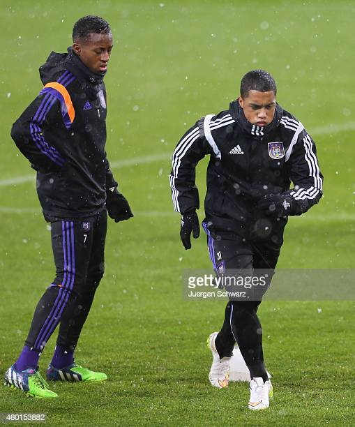 Youri Tielemans of Anderlecht warms up beside Andy Najar during a practise session one day ahead of the Champions League Group D football match...