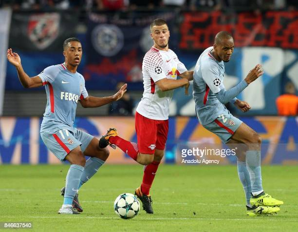 Youri Tielemans of AS Monaco and Diego Demme of Leipzig and Fabinho of AS Monaco battle for the ball during the UEFA Champions League group G match...