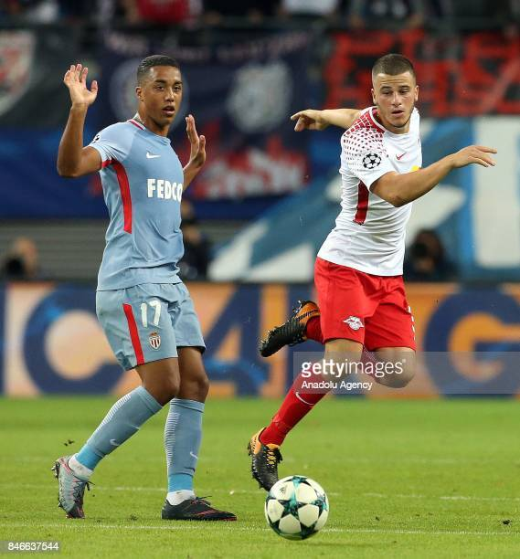 Youri Tielemans of AS Monaco and Diego Demme of Leipzig battle for the ball during the UEFA Champions League group G match between RB Leipzig and AS...