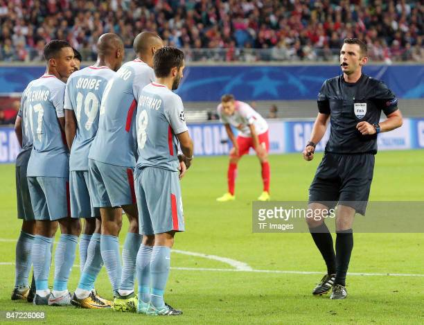 Youri Tielemans of Monaco and Djibril Sidibe of Monaco and Fabinho of Monaco and Joao Moutinho of Monaco and Michael Oliver looks on during the UEFA...