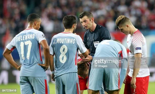 Youri Tielemans of Monaco and Joao Moutinho of Monaco and Schiri and Michael Oliver and Fabinho of Monaco and Marcel Sabitzer of Leipzig looks on...