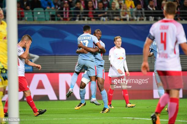 Youri Tielemans of Monaco is congratulated by Almamy Toure of Monaco after equalising during the Uefa Champions League match between RB Leipzig and...