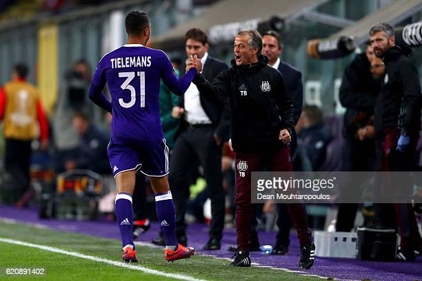 Youri Tielemans of RSC Anderlecht celebrates with members of the coaching staff after scoring his team's thirkd goal during the UEFA Europa League...