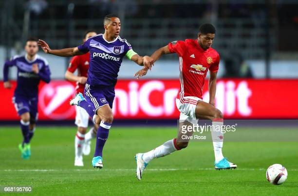 Youri Tielemans of RSC Anderlecht chases Marcus Rashford of Manchester United during the UEFA Europa League quarter final first leg match between RSC...